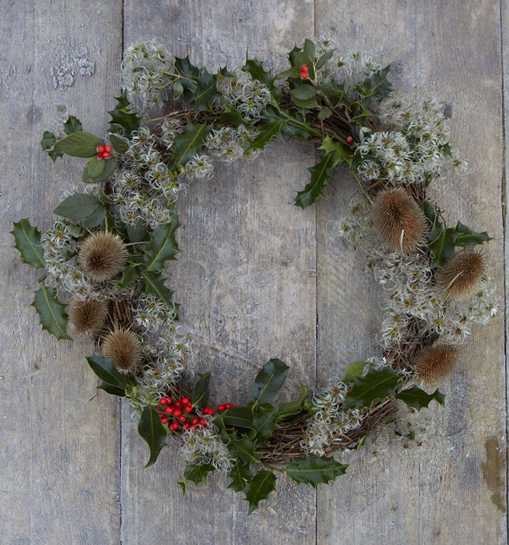Seed heads of common teasel and wild clematis on a wreath.