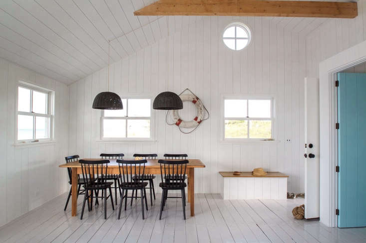 In a Cape Cod cottage, painted wood floors have a practical high-gloss finish, which also brightens the space. For more, see A Shipshape Cape Cod Cottage Inspired by Wes Anderson's 'The Life Aquatic'.