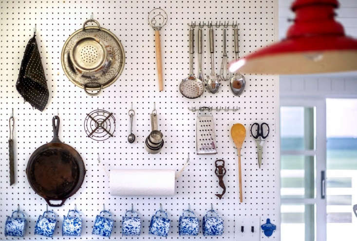 A highly organized yet somehow casual and relaxed kitchen, thanks to a hardworking pegboard wall. Photograph by Justine Hand for Remodelista, from Kitchen of the Week: A Compact, Nautical Entertaining Kitchen on Cape Cod.