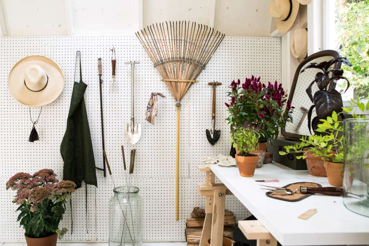 A wall of peg board keeps garden accessories and tools tidy. &#8