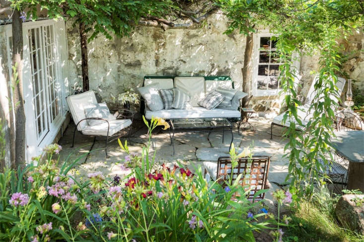A sunny terrace is just one of many inviting spots to plop down with a book (Tomkins owned so many that her personal library was in 68 the subject of a newspaper feature story on &#8