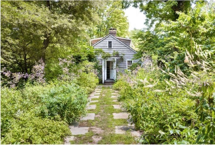 A grass path with stepping stones is bordered by lacy perennials and frothy foliage. Photography courtesy of Sothebys Realty, from A Life Lived Fully: Artist and Photographer Judy Tomkins in Sneden&#8\2\17;s Landing, NY.