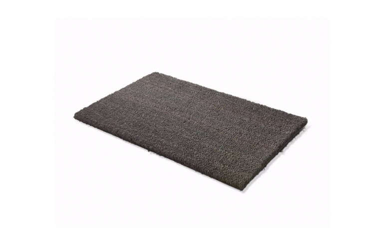 A twist on a classic, the Fuss Matte Bison is a black coconut fiber mat with a vinyl backing that is made in the Eifel, a region in Germany, for € at Magazin.