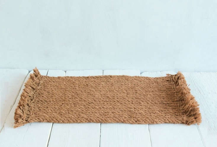 The Natural Handwoven Rope Coir Door Mat is a braided version with tassel edges; $3