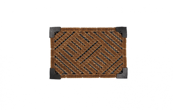 Made in Sir Lanka, aCoir Door Mat framed by non-slip black rubber corners measures approximately .5 by .75 inches and is $53 from John Lewis.