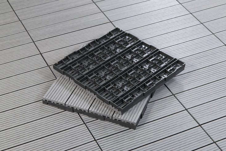 Made of 60 percent recycled bamboo fibers and 40 percent recycled HDPE plastic, Slate Composite Deck Tiles are \$5.83 per square foot from Cali Bamboo.