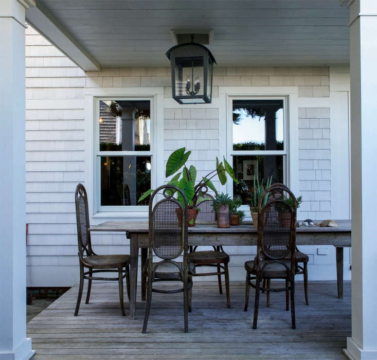 Philip and Kristin frequently dine al fresco with friends and lodgers; a suite of antique Thonet chairs surrounds a long American farm table from Nellies of Amagansett.