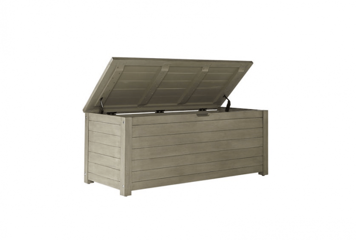 For use outdoors, aSalento Storage Bench made of solid acacia wood measures \20 by 48 inches (and is \19.5 inches high) and is \$4\19 from CB\2.