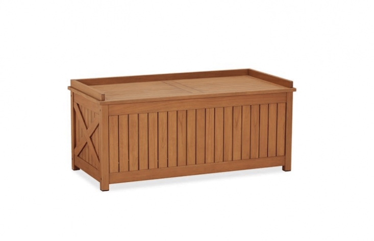 Pottery Barn&#8\2\17;sHampstead Teak Storage Trunk has a &#8\2\20;gallery rail along the top, X-detailing on each side, and a classic planked design.&#8\2\2\1; It is on sale for \$686.99 (marked down from \$\1,374).