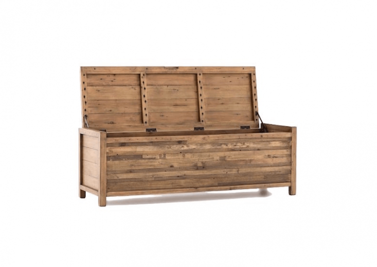 A Bay Outdoor Storage Bench constructed of FSC-certified reclaimed pine is suitable for use in a covered entryway. It is 53 inches long and \15.\25 inches deep and \17.75 inches high. Available online only, it ships from the manufacturer and is non-returnable; \$699 from West Elm.