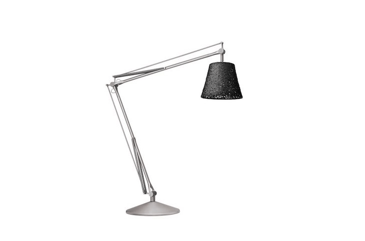 A weather-resistant Outdoor Task Lamp from Archimoon has a plastic diffuser made of woven PVC tubes. The floor lamp is suitable for use in a damp location; 84 inches high, it is \$\14,950 from All Modern.