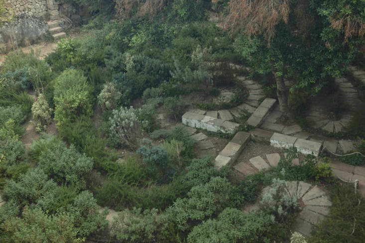 The herbal labyrinth; a new garden developed from an abandoned market garden, with walled protection from the elements.