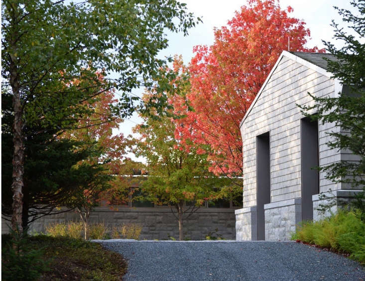 After crossing a granite bridge, a gravel driveway leads to a carriage house and a main house. See more of this driveway and garden at Lessons from the Land: Finding a Lost Landscape on the Coast of Maine. Photograph by Jonathan Levitt, courtesy of the American Society of Landscape Architects.