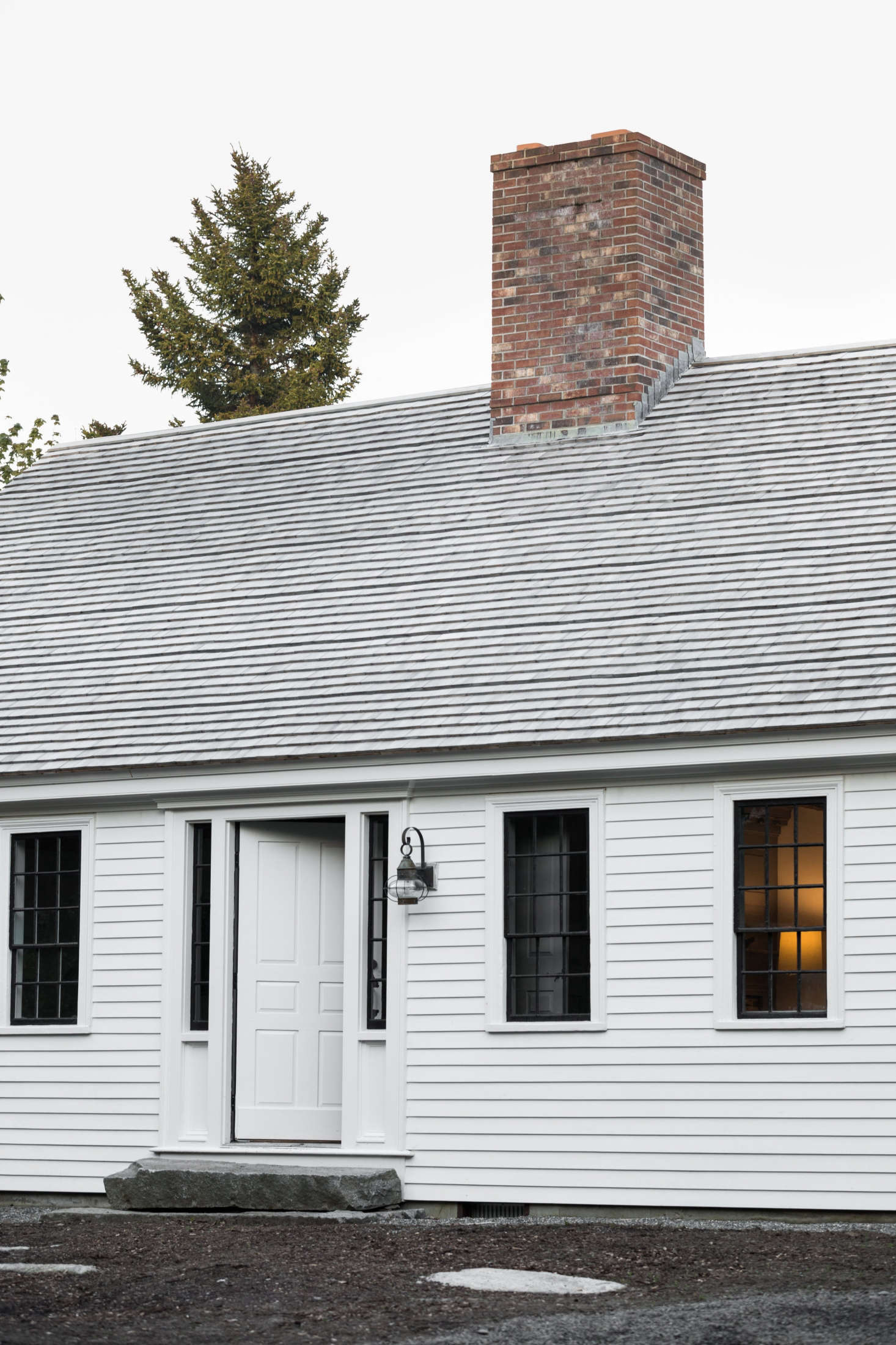 The exterior of the Cape is painted in an oyster-white milk paint. (For something similar, considerOyster White by Old Fashioned Milk Paint.)