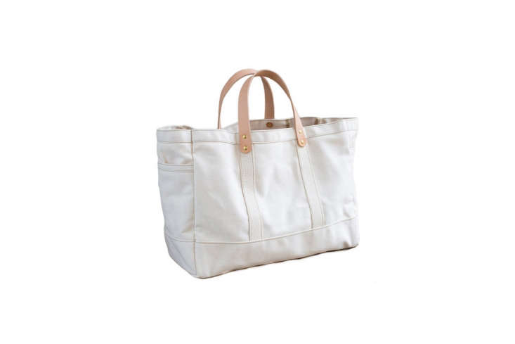 The Artifact Tool and Garden Tote in natural canvas and tanned leather handles has pockets on either side; \$\138 at AHA.