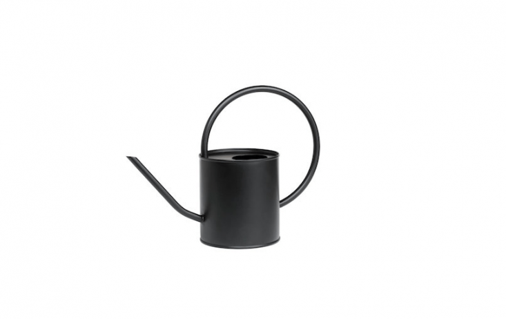 On sale at H&M, a small Metal Watering Can is 4.\25 inches high; \$\19.99.