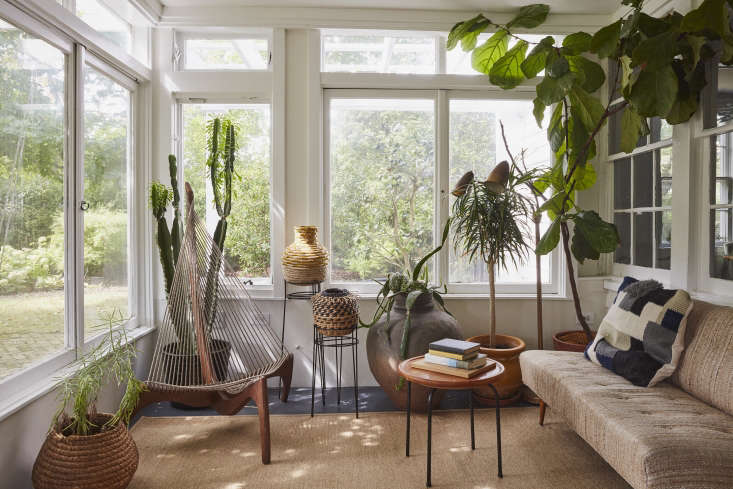 In a sunroom on Long Island, designer C.S.Valentin unified a disparate collection of desert and tropical plants in pots made by his brother, David Haskell ofDGH Studio.Photograph byJonathan Hökklo, styling by Alexa Hotz.