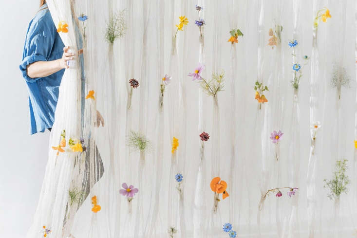 Each \10-by-\10-foot Draped Flowers curtain panel has more than \100 pockets in which to tuck in a flower; \$3,800 per panel from Umé Studio.