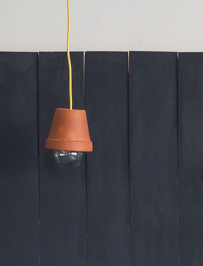 Stylish and practical, the flowerpot pendant light is one of  easy DIY projects in our Gardenista book.