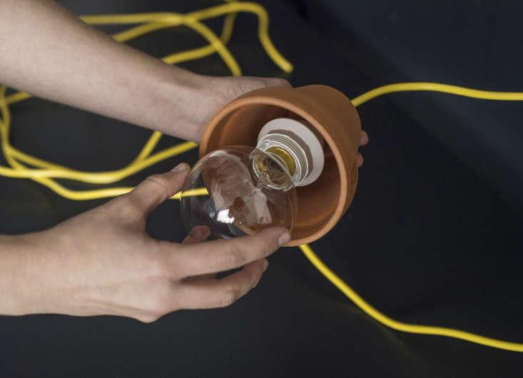 After assembling, screw in the lightbulb.