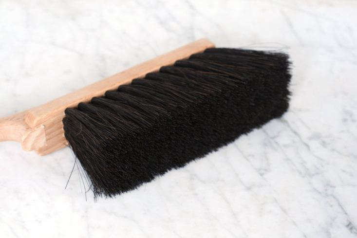 The brush has Arenga palm fiber bristles and is \13 inches long.