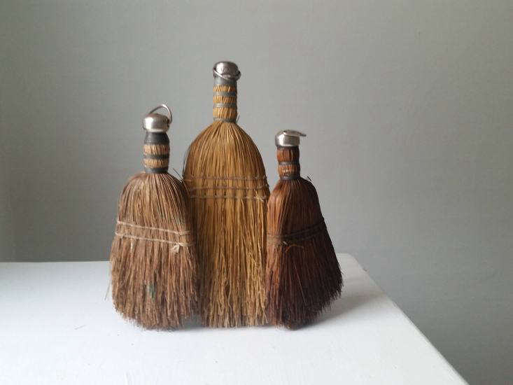 A set of three display-worthy vintageWhisk Brooms from the 60s have straw bristles and metal hangers; $3