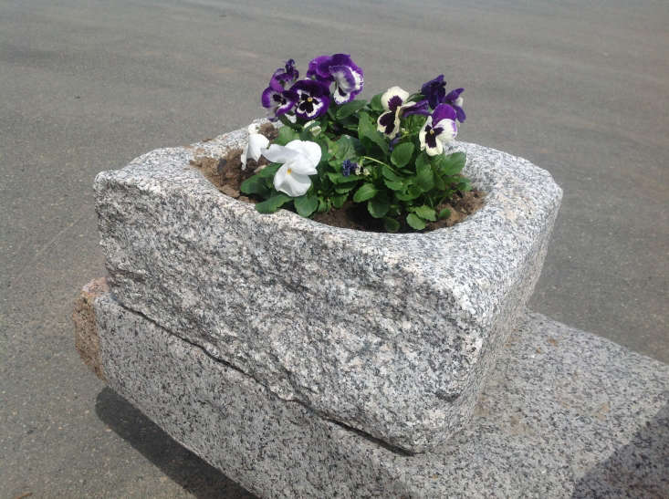 One-of-a-kind Reclaimed Granite Planters are available from Olde New England. For more information and prices, see Olde New England.