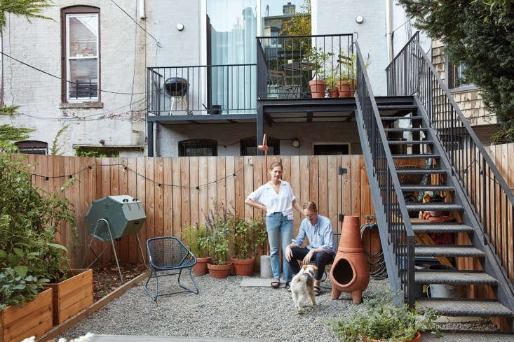 """""""We've always had a strong interest in plants, but never had an actual garden before this house,"""" says Lauren, pictured here with Keith and their dog."""