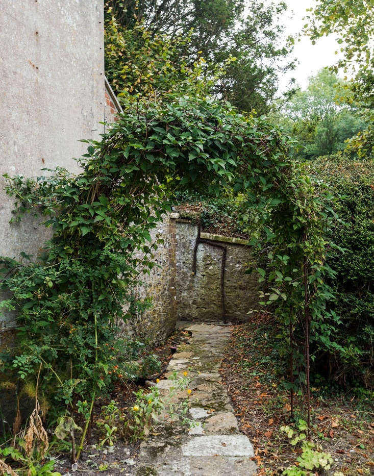 A crooked stone path beckons at the edge of Pentreath and McCormick&#8\2\17;s garden.