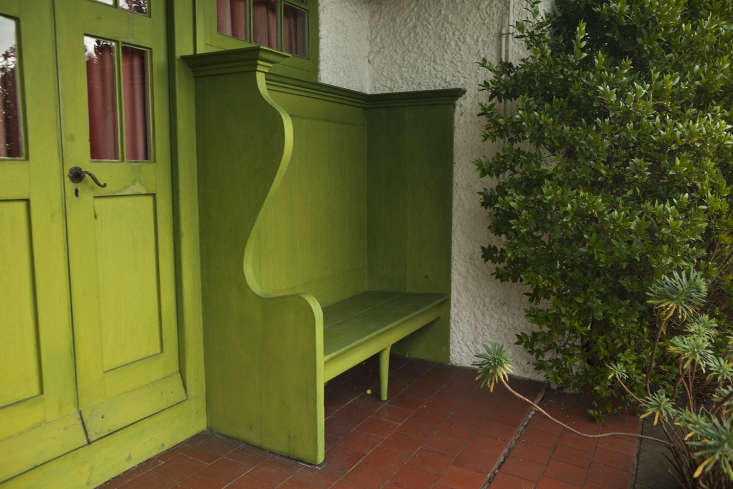 A built-in bench by the back Smoking Room door.