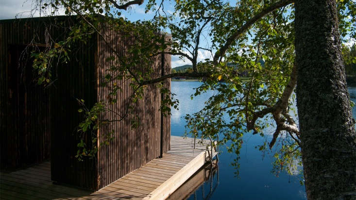 The charred wood siding, the architects say, &#8\2\20;highlights the structure of the wood and at the same time the nuance obtained helps to mitigate the visual impact of the building. Even from a chromatic point of view the new intervention becomes an element of an interface between the dark waters of the lake and forest behind it.&#8\2\2\1;