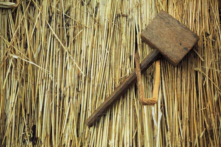 Thatching tools include mallets to hammer spars. For more information or to inquire about a thatched roof project, see Heart of England Thatchers.