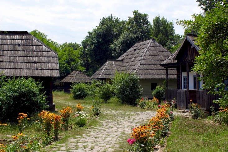 Wildflowers edge a stone path in a Transylvania village. Photograph by Tim Sheerman-Cae via Flickr.