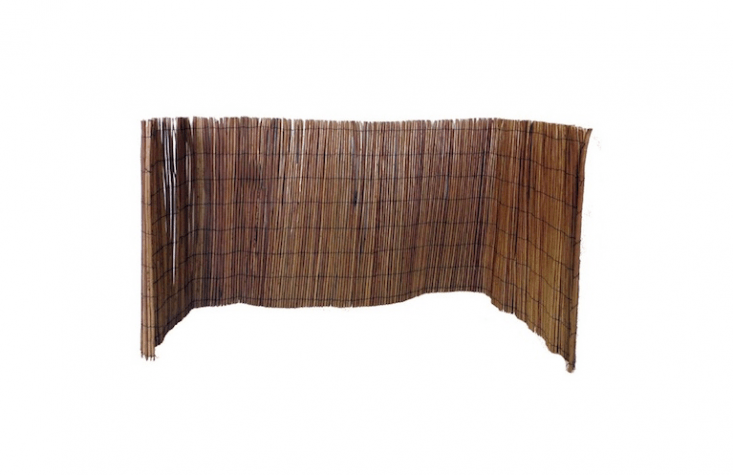Panels of Willow Rolled Fences can be formed into enclosures to hid the air conditioner unit; available in five heights and three lengths at prices from \$\29.\1\1 to \$88.5\1 from Master Garden Products.