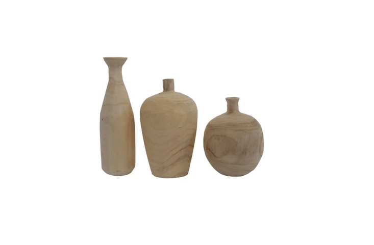 A three-piece set of Paulownia Wood Vases is \$58.6\1 at All Modern.