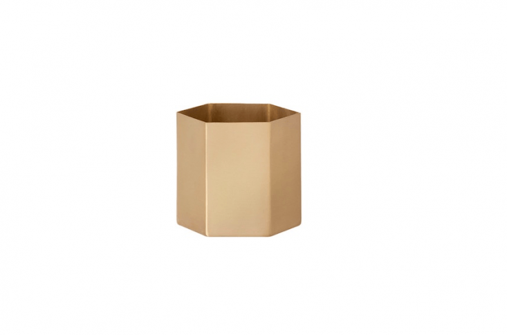 Made of solid brass with a matt lacquer finish and available in three sizes, a Hexagon Flowerpot by Ferm Living is from \$45.50 to \$80.50 depending on size from Connox.