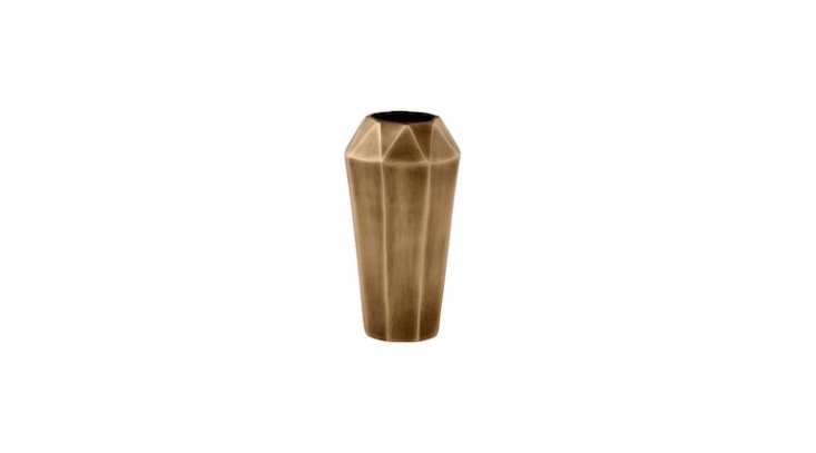 Faceted Metal Vases in an antique brass finish &#8\2\20;use the decadent architectural vibe of the '\20s and '30s with a clean-lined modern feel,&#8\2\2\1; says retailer West Elm. The vases are available in five sizes including medium as shown at prices from \$\24 to \$69.