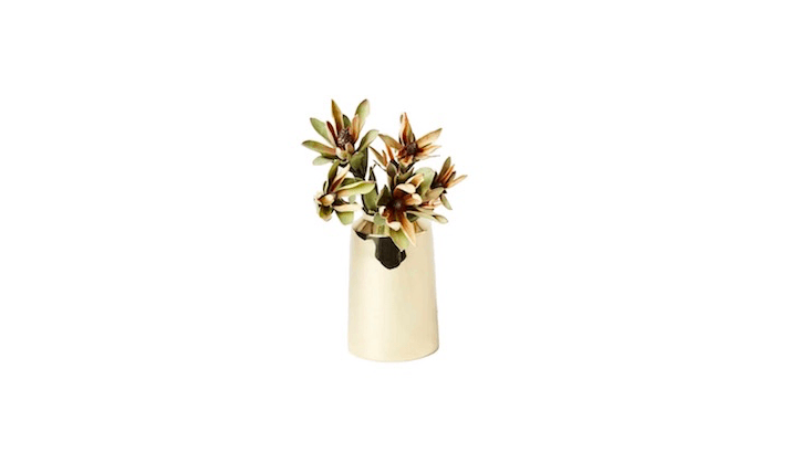Made in Sweden, an Ink Brass Flower Vase is \$\165 CAD (about \$\130 US) from Mjolk.
