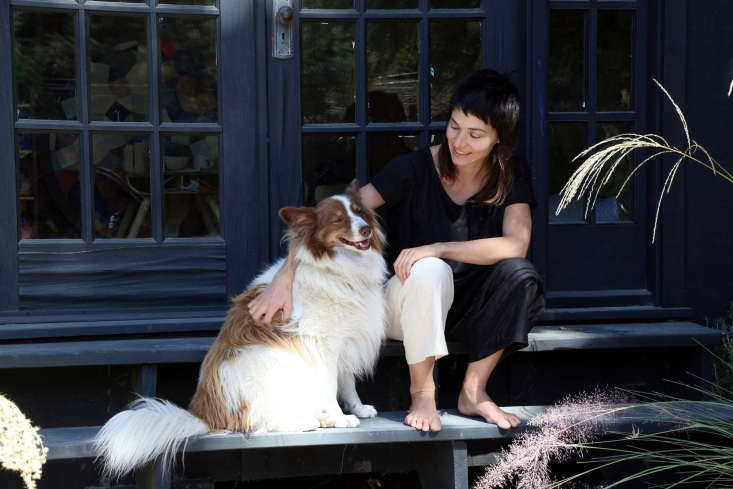 Artist Carly Jo Morgan and her dog.