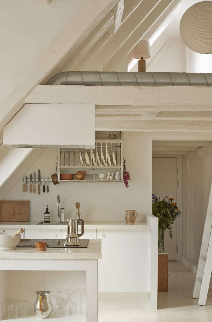 This all-white kitchen sits beneath a lofted home office on the top floor of the historic building. Photograph courtesy ofKatrine RohrbergfromDanish Heritage: A Copenhagen Townhouse Renovated by Hand. Alexa shares how to replicate the look in Steal This Look: A Pale and Perfect Under-the-Eaves Kitchen in Copenhagen.