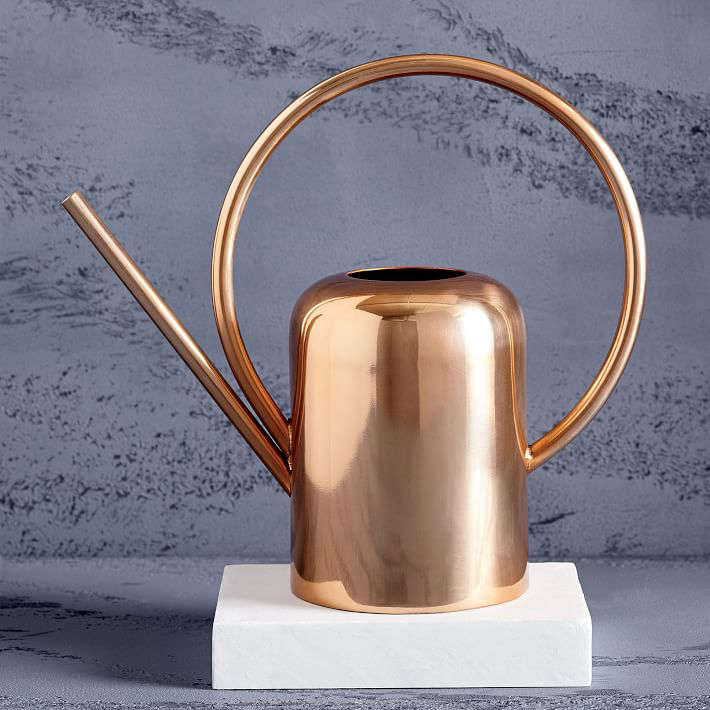 For houseplants, a shinyModern Copper Watering Can is \1\2 inches high; \$69 from West Elm.