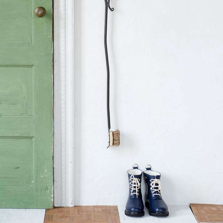 Elevate the humble boot brush to art object. A wall-mountedIron Boot Brush has a loop for hanging (and comes with matching hardware). The brush has natural cocoa fibers; \$98 from Terrain.