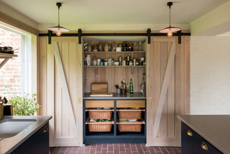 The modern root cellar; Erlam stores vegetables in baskets behind a pair of rolling barn doors.