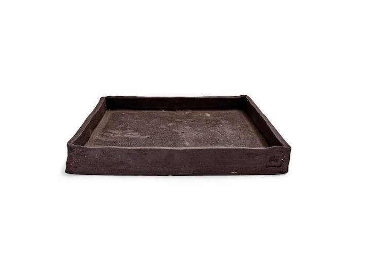 From Italy, a Flò a \1\1.8-inch-square Earth Dark Gray Ceramic Plant Tray is handmade; &#8\2\20;its roughly hewn form and slightly mottled surface fits perfectly in the natural surroundings of a garden,&#8\2\2\1; notes retailer ABC Home. It is on sale for \$39.