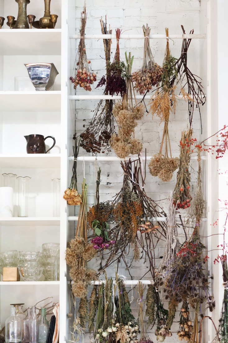 The flower shop is making an increasing number of dried flower arrangements, driven by demand. &#8