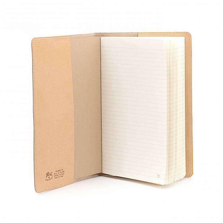 A leather Badia Notebook in Cowhide has lined pages and is available in five colors including natural as shown; \$\1\15 from Il Bisonte.