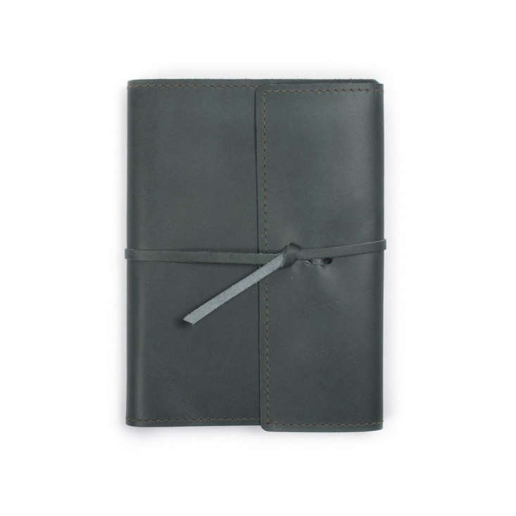 A large refillable Writers Log Leather Notebook is available in seven colors including Ocean as shown; it has a flap tie closure for extra protection and is $45 at Rustico (for an additional $ it can be personalized).