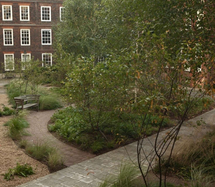 The newer design includes a meandering brick path and extra seating, which is why the garden is now inhabited, instead of only providing a way of getting from A to B.