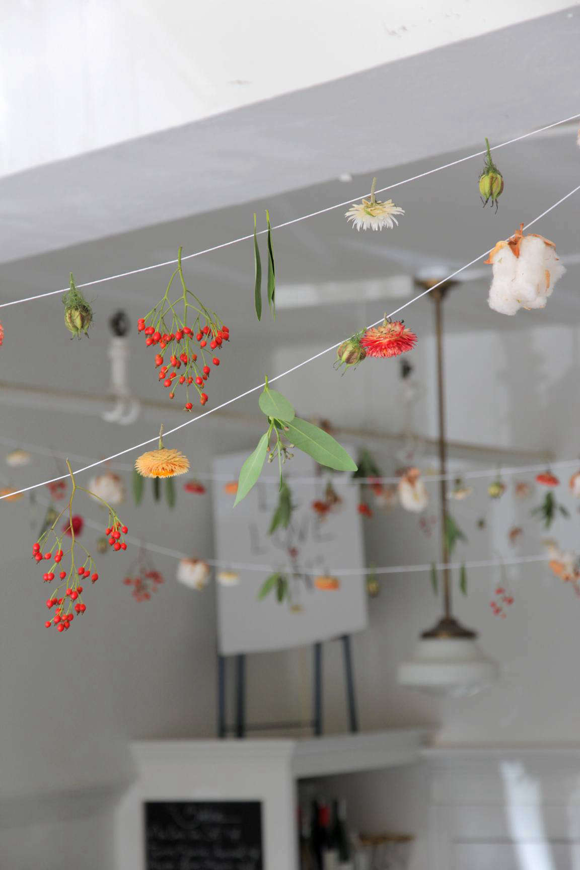 """We fell for the artful, ad-hoc garland strung across the ceiling of Måurice, a tiny Norwegian- and French-inspired """"modern pastry luncheonette"""" in downtown Portland, Oregon, when we featured the cafe interiors on Remodelista. Fortunately the pastry chef and the florist behind the garland shared their secrets with us; read more inDIY: An Artful Botanical Garland by Måurice in Portland, OR, on Remodelista."""