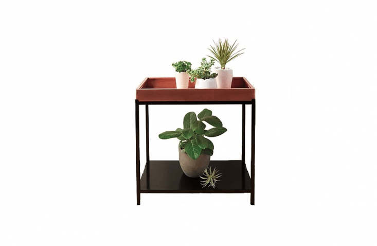 ACopper Plant Stand with a removable tray and a powder coated steel base is \$\298 from Gump&#8\2\17;s.